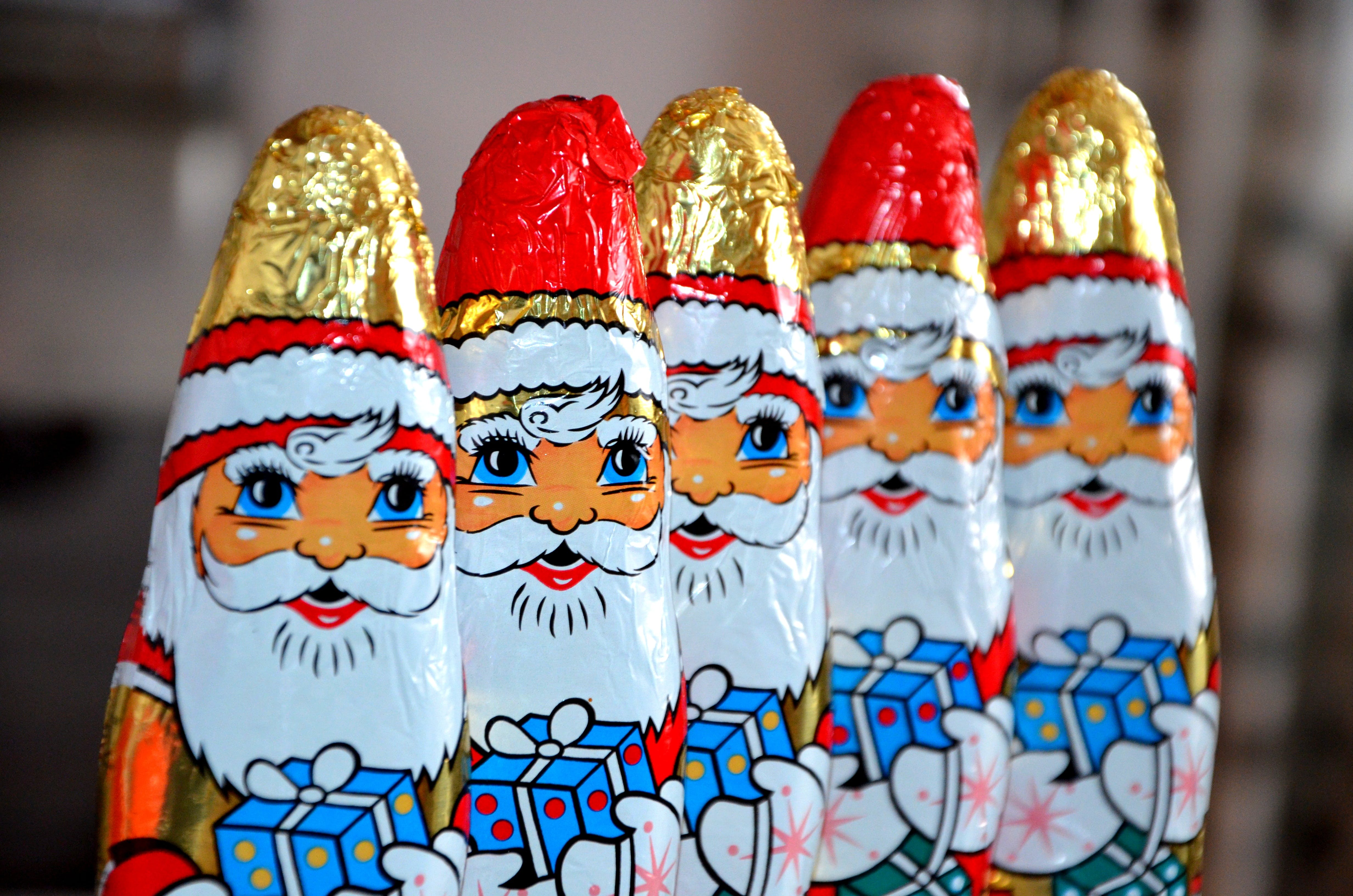 Red White Gold and Blue Santa Claus Carrying Gift Sweets Line