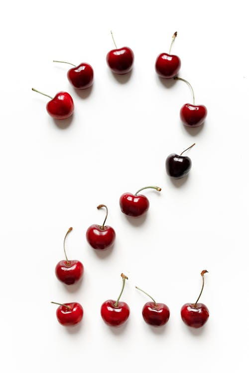 Red Cherries on White Surface