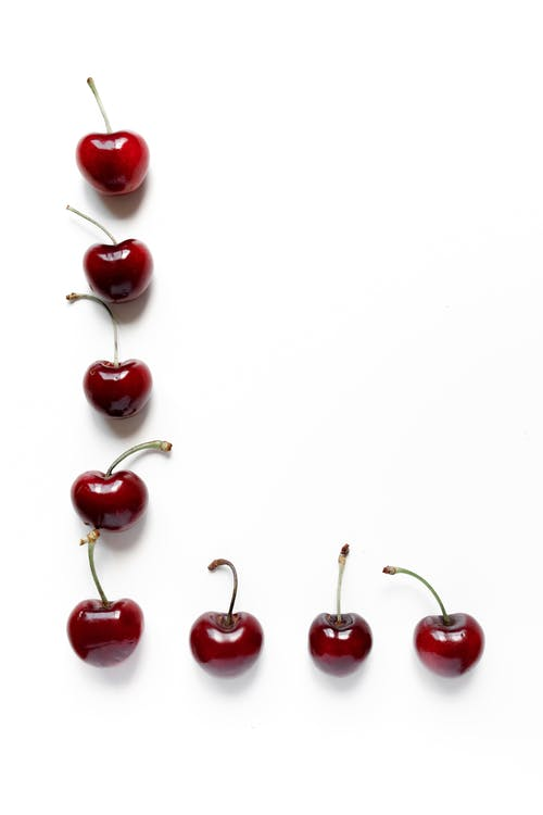 Red Cherries on White Background