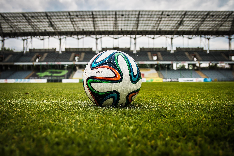 White Black and Green Soccer Ball on Soccer Field