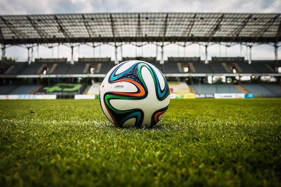 White Black and Green Soccer Ball on Soccer Field