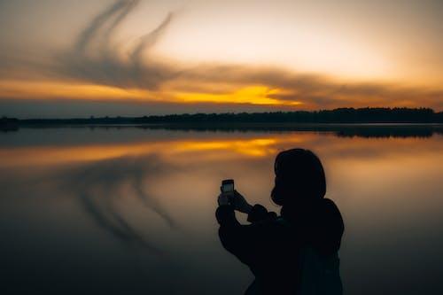 Foto stok gratis air, backlit, bayangan hitam