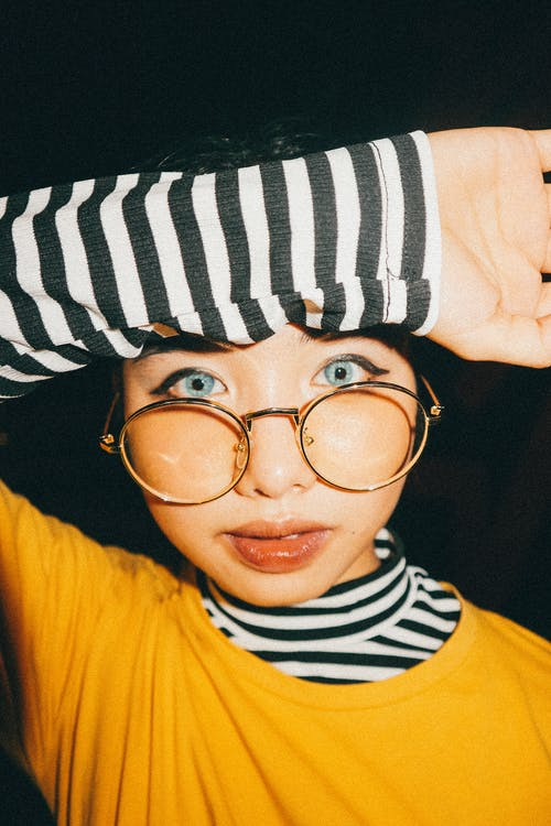 Boy in Yellow Crew Neck Shirt Wearing Black and White Striped Knit Cap