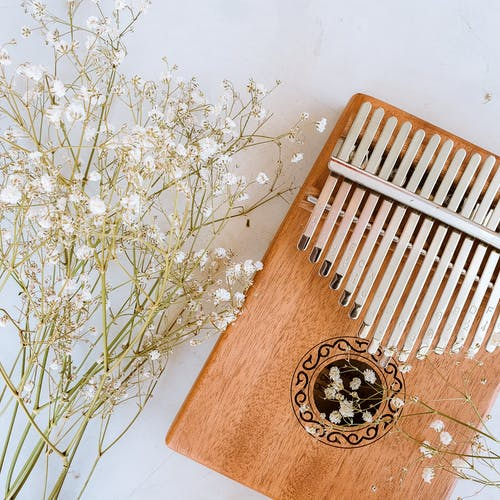 Brown Wooden Board With White Flowers