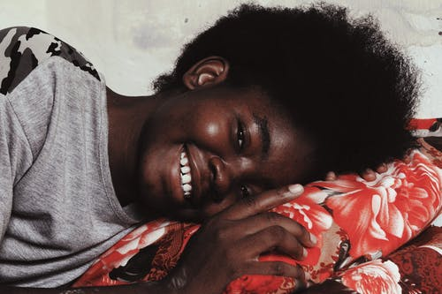 Woman in Gray Shirt Smiling