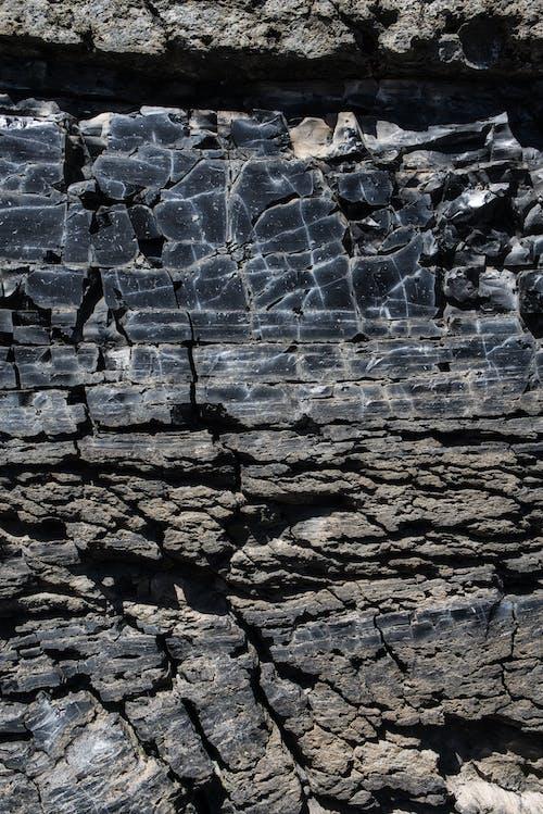 Gratis arkivbilde med abstrakt, geologi, grå, grov
