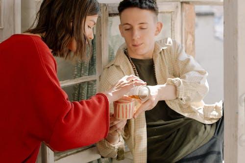 Woman in White Knit Sweater Holding White Ceramic Mug