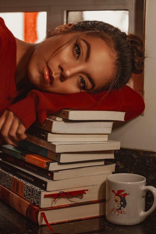 Woman in Red Shirt Holding White Ceramic Mug
