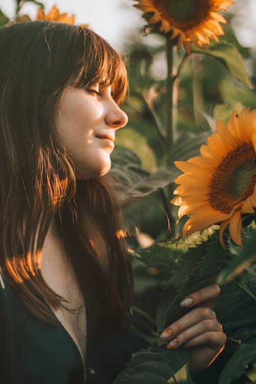 Peaceful woman enjoying sun and nature