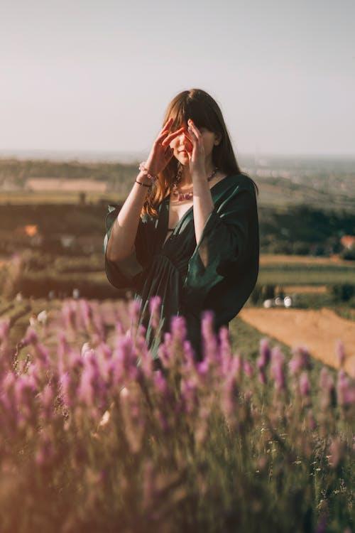 Woman standing in blooming field