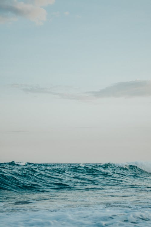 Ocean Waves Under White Sky