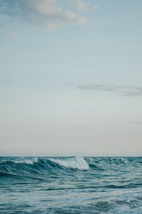 Ocean Waves Under Gray Sky