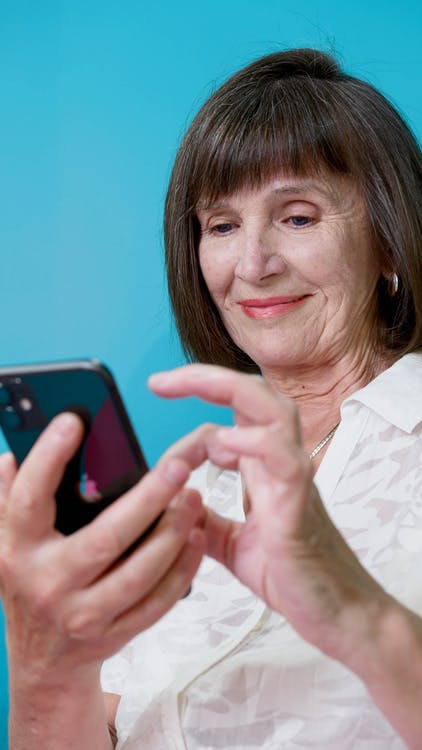 Elderly Woman Busy Texting