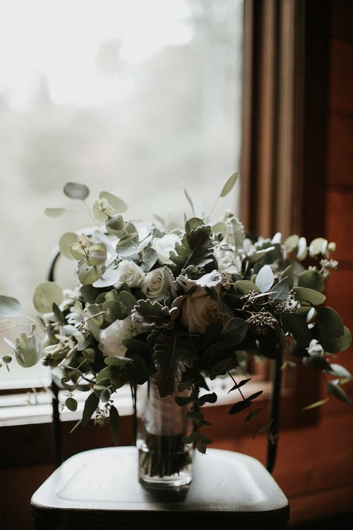 White Flowers on Brown Wooden Table