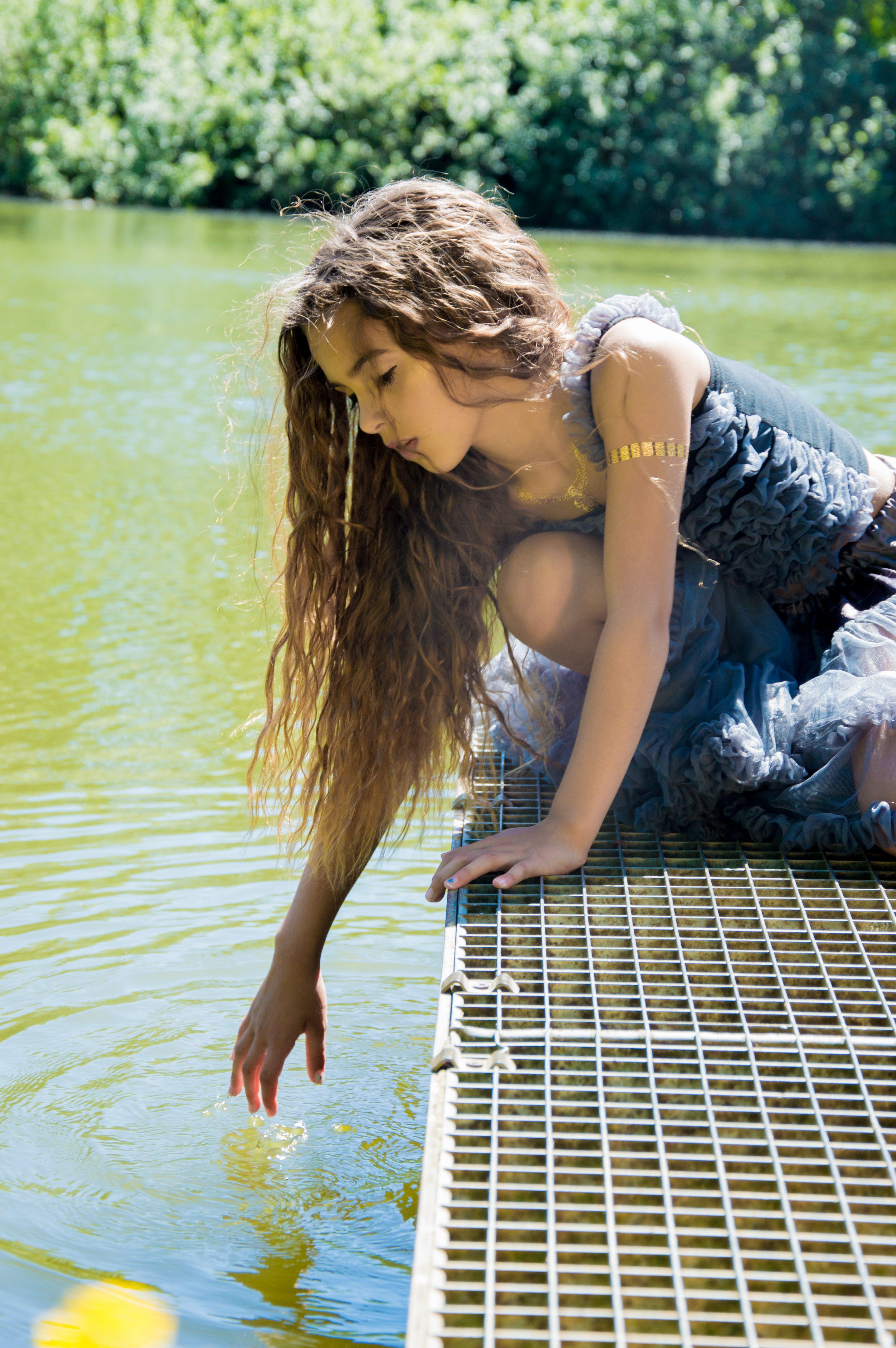 Girl on Dock Near Body of Water