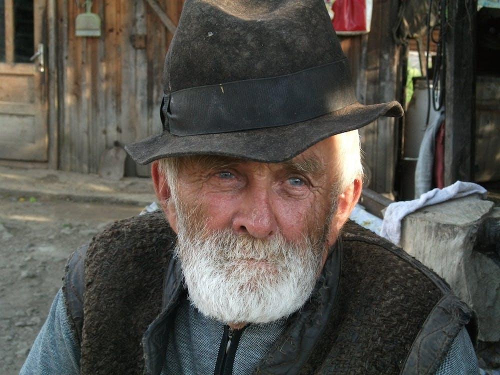 Man With White Beard Wearing Black Hat during Daytime