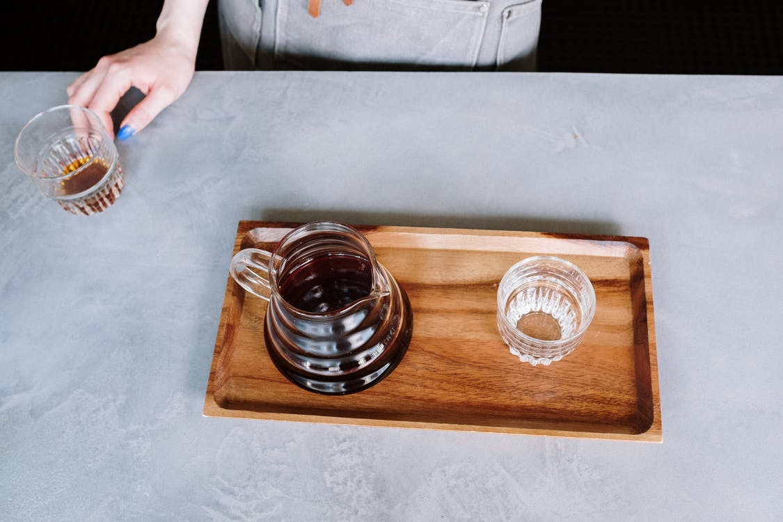 Clear Glass Cup on Brown Wooden Tray