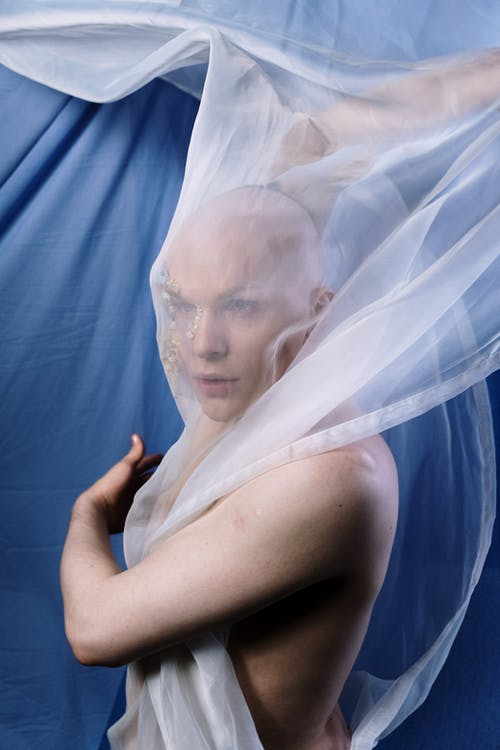 Woman in White Veil Covering Her Face