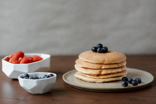 Pancakes With Berries on White Ceramic Bowl