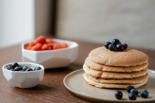 Pancakes With Berries on Ceramic Plate