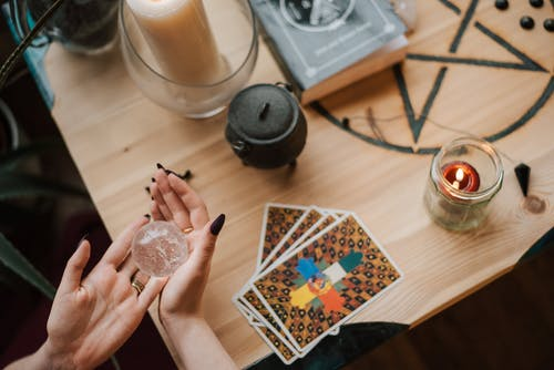 Crop soothsayer predicting fate with magic ball at home