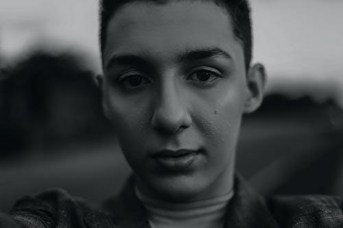Androgynous young man looking at camera