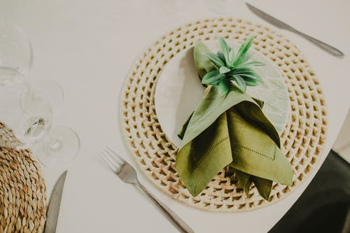 Exquisite table setting with napkin on white plate