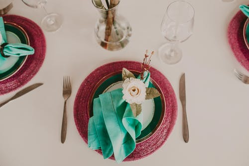Stylish banquet table with napkins and decorative flowers