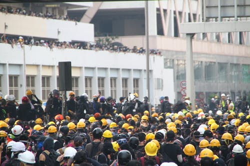Crowd of workers on mass meeting for rights
