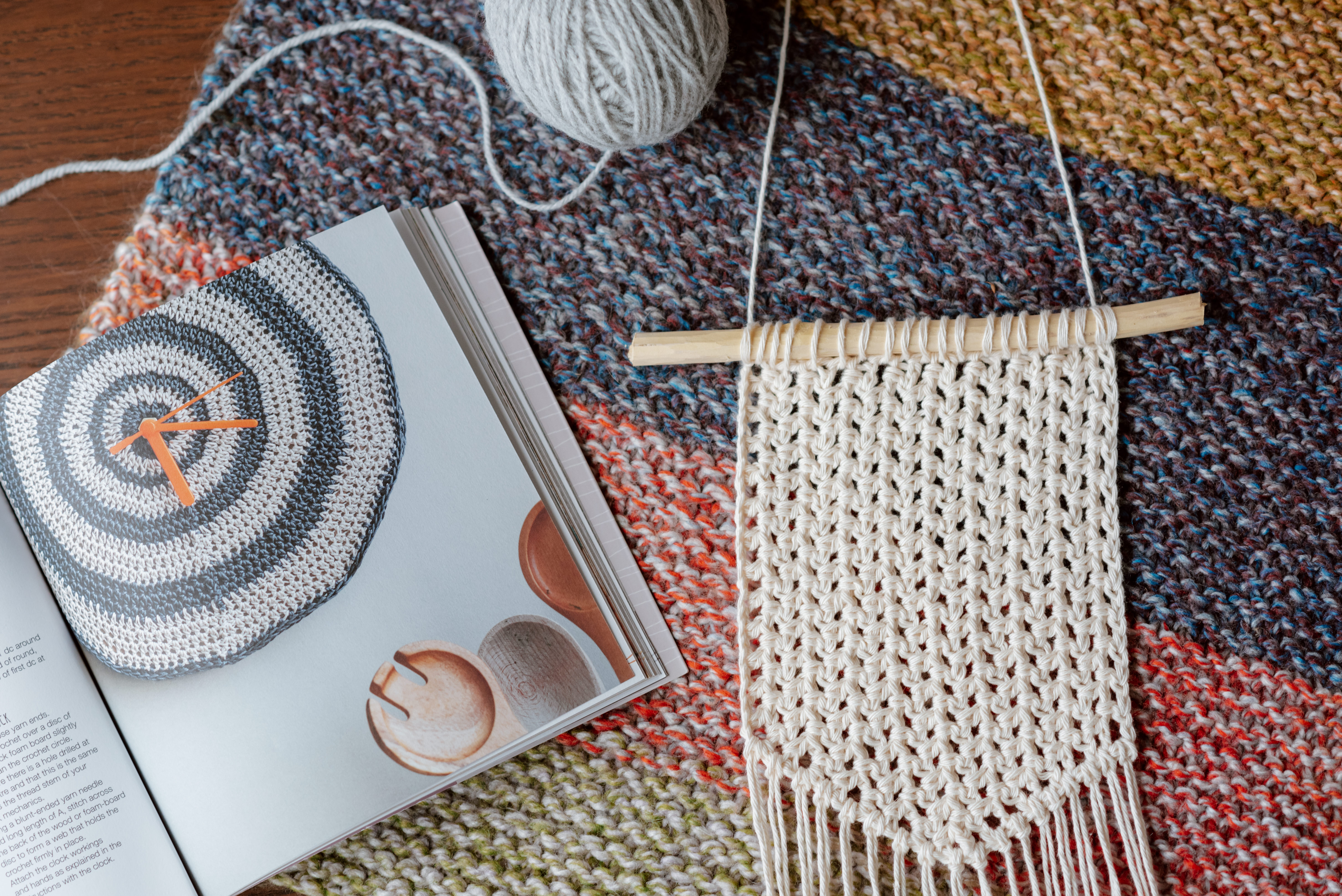 knitted piece near magazine with manual