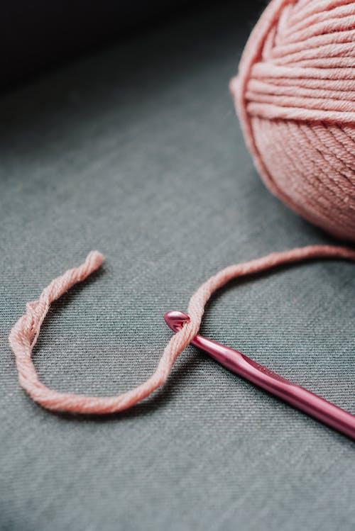 Pink yarn and crochet hook