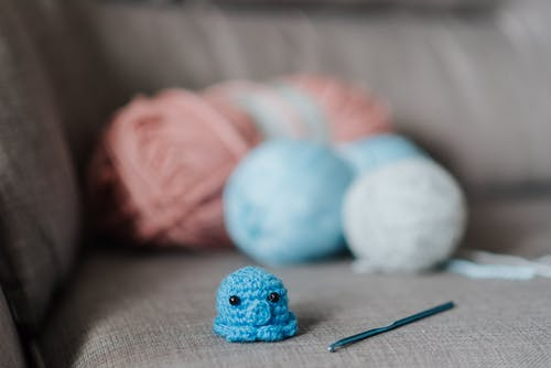 Crocheted toy on couch at home