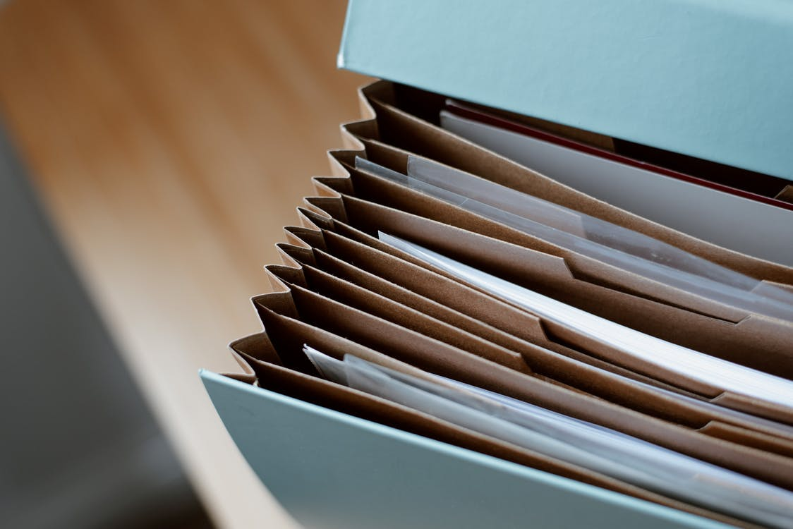 High angle of opened briefcase for documents with papers PIM for Shopify B2B buyer experience