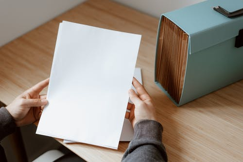 Person showing sheet of paper