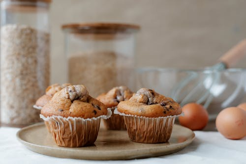 Yummy homemade muffins near ingredients on table