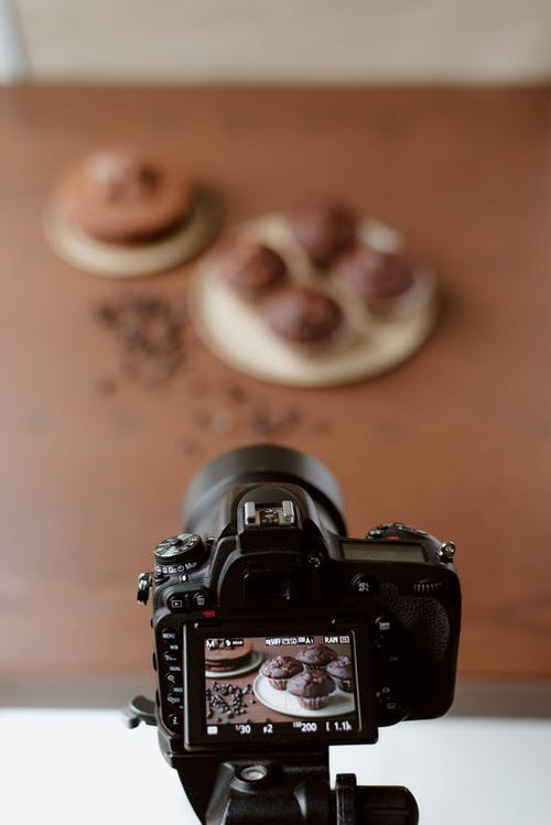 Display of modern photo camera with image of baking products