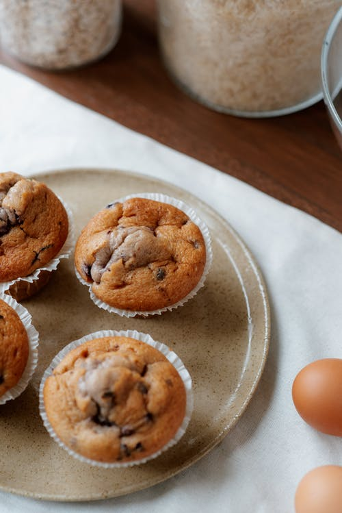 Set of tasty homemade muffins on plate