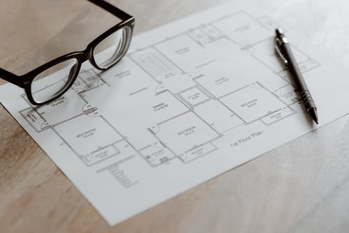 Set of scheme and pen with glasses on table