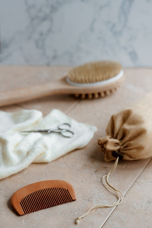 Eco friendly bath brush and comb on table