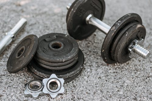 2 Black Dumbbells on Gray Rock