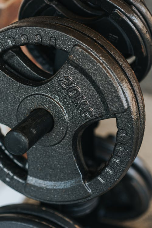 Modern dumbbells with shiny black metal plates