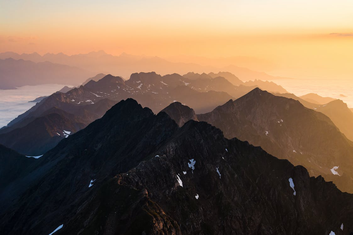 Black and White Mountains Under White Sky