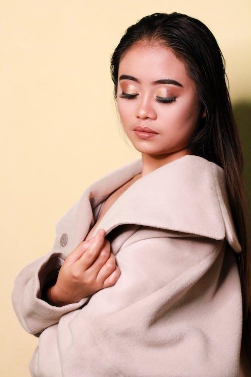 Stylish ethnic woman in trendy coat