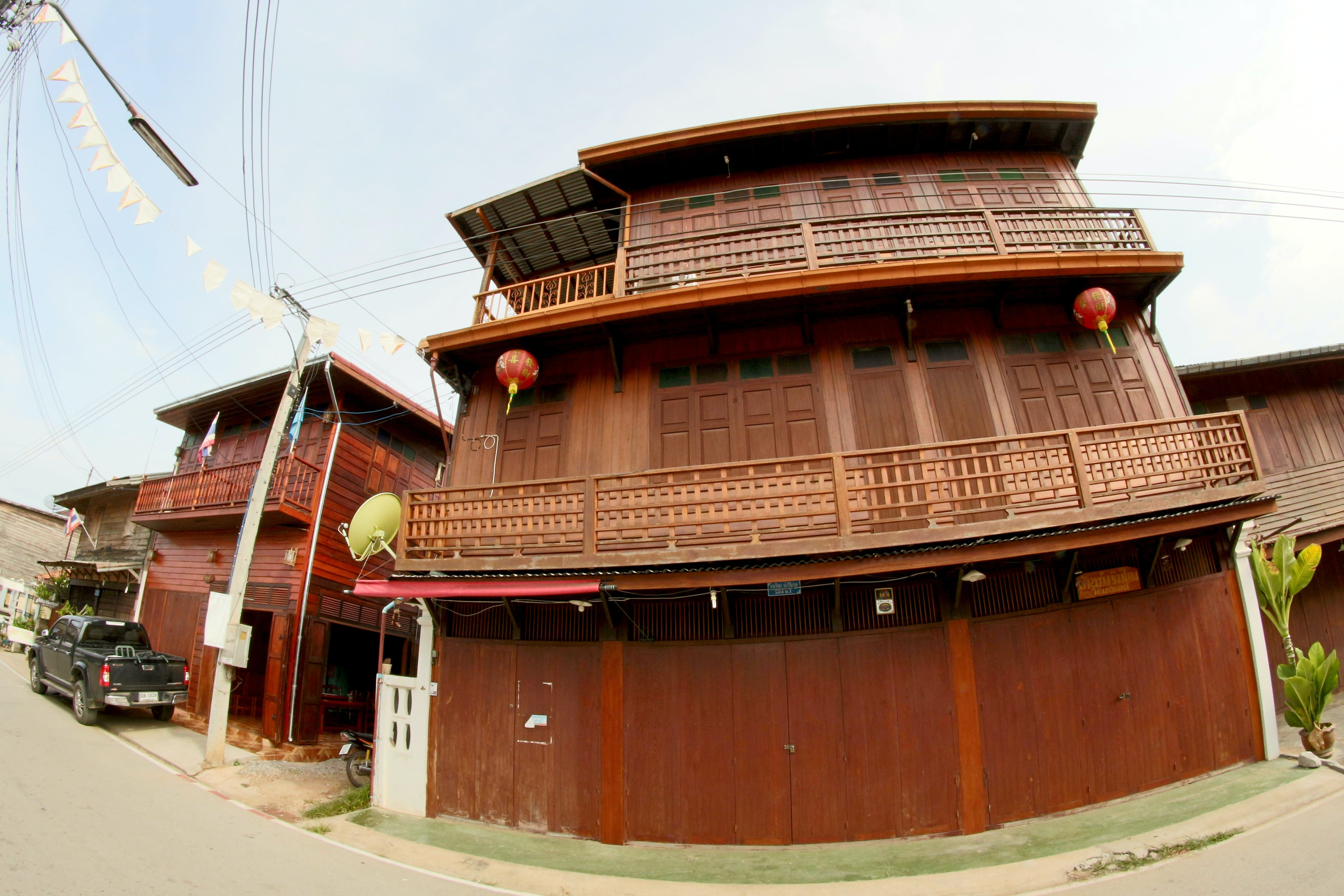 Brown Wooden 3-storey House