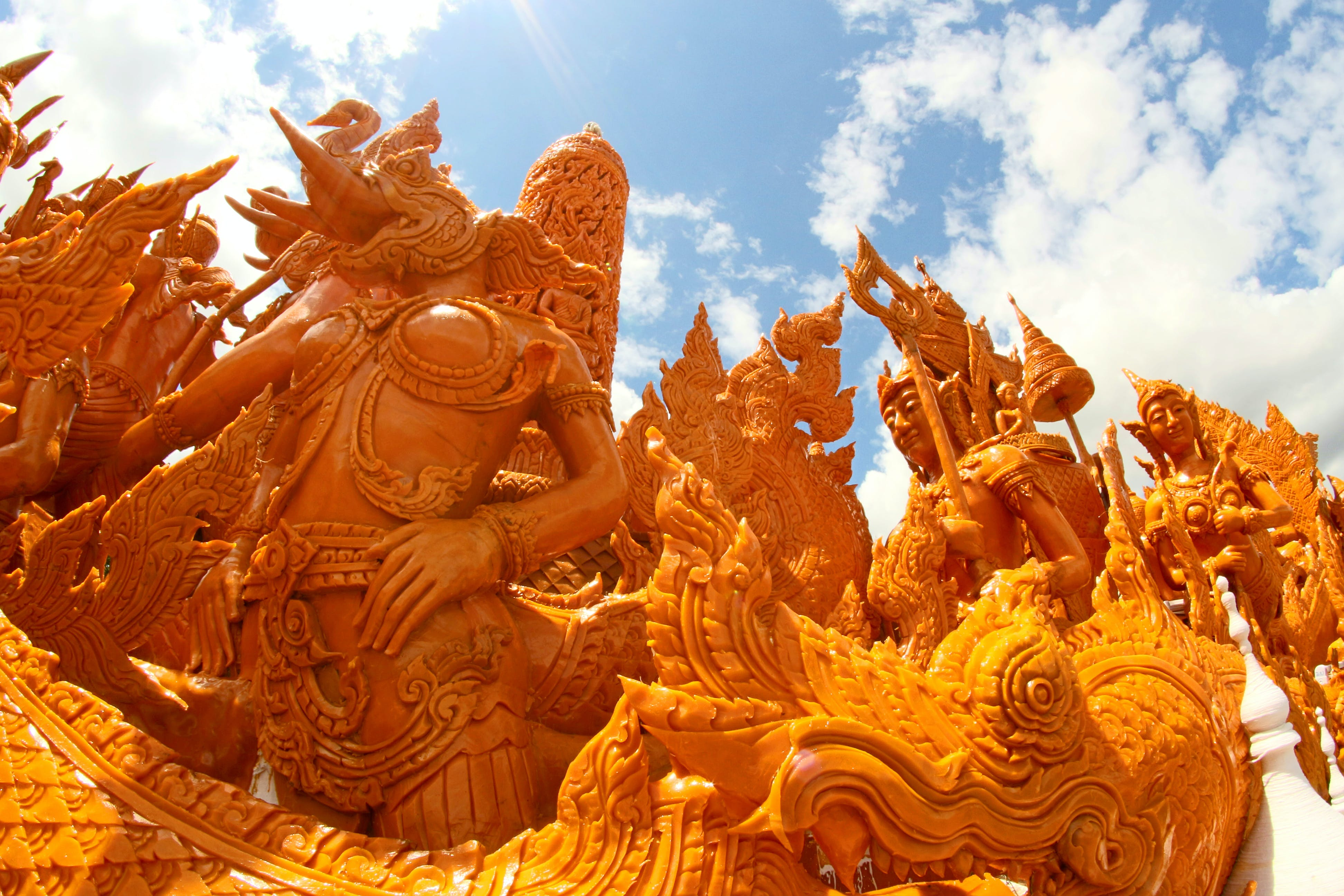 Golden Character Statues Under Blue Sky