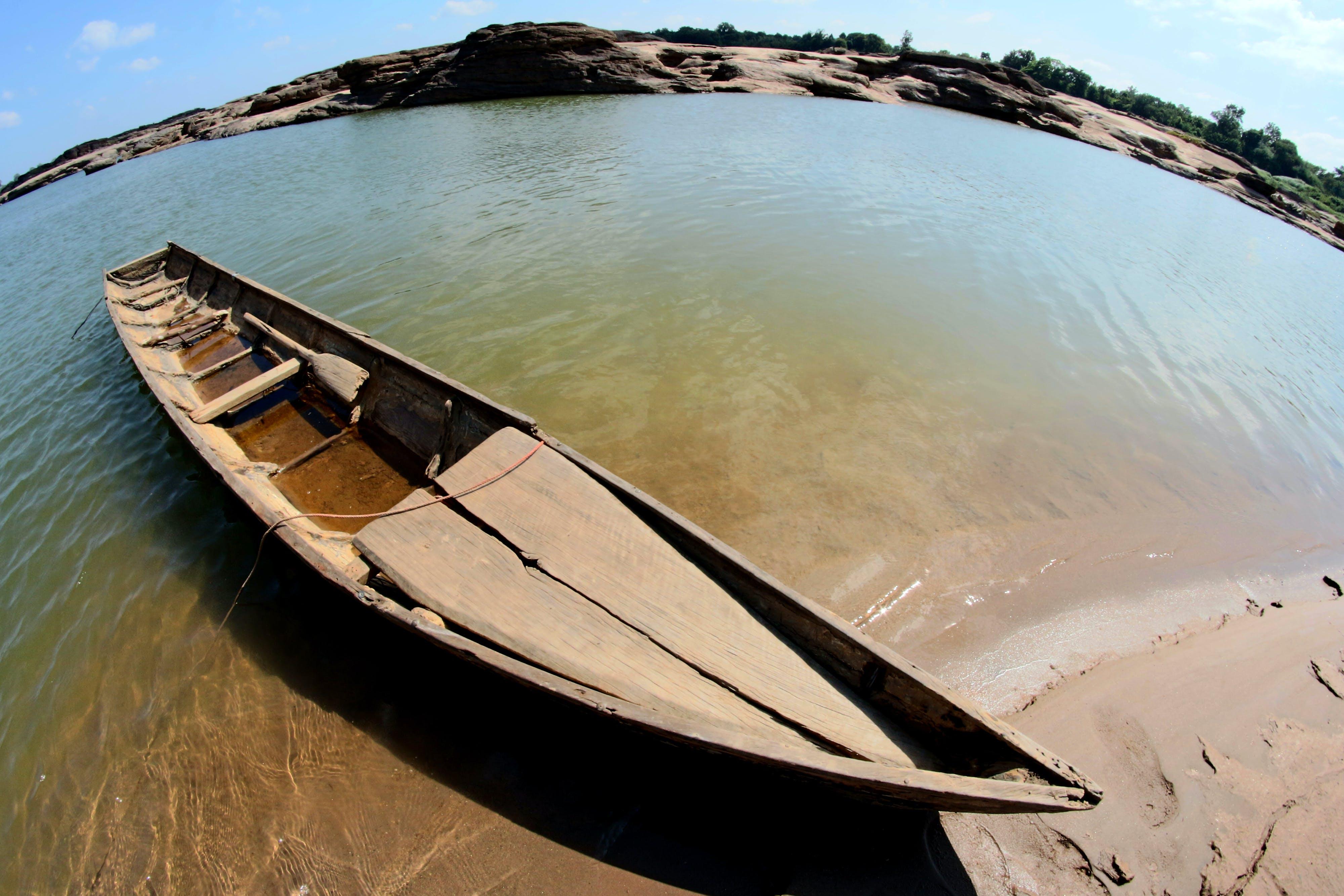 Gray Canoe at Shoreline