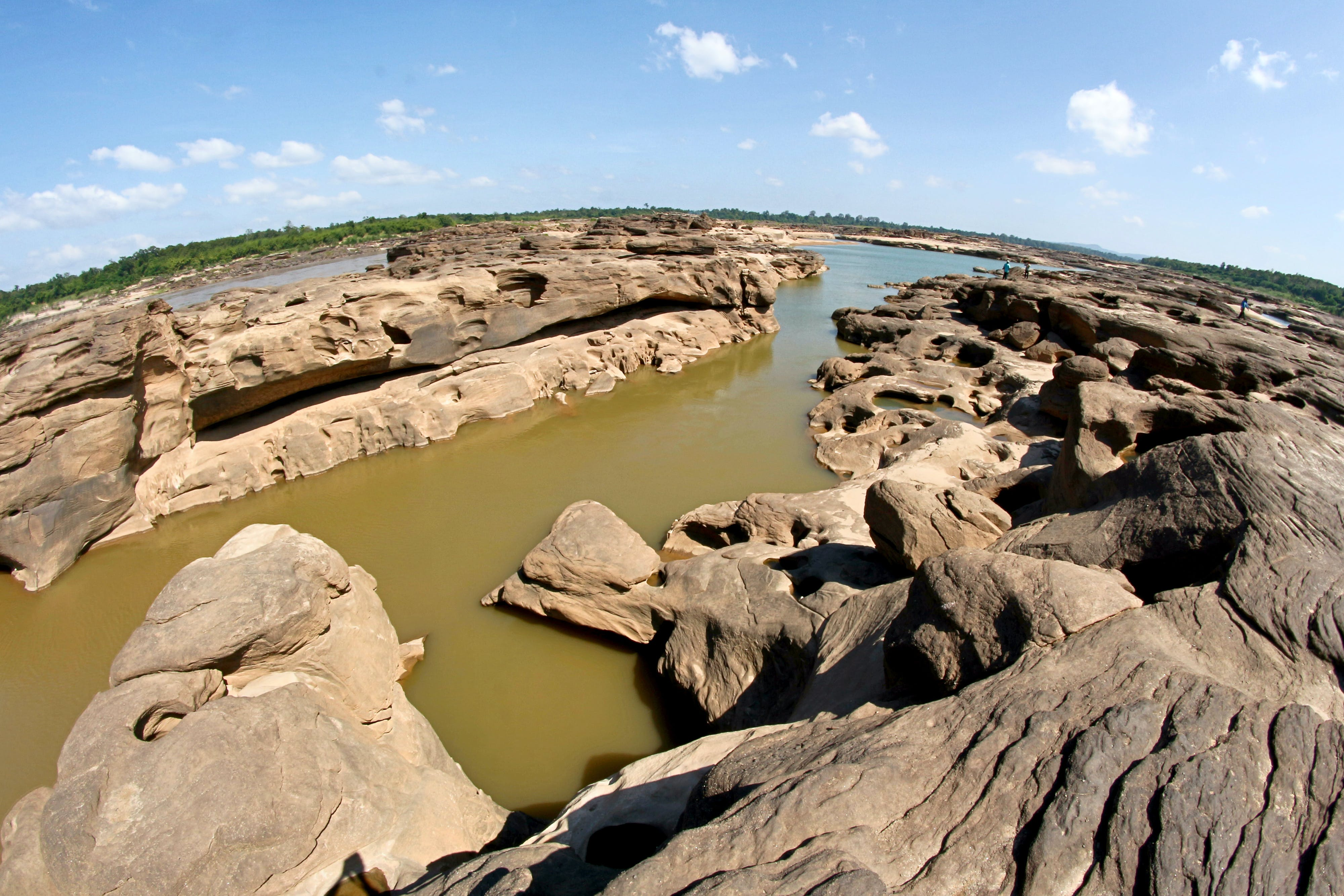 Body of Water and Rock Formation Stones