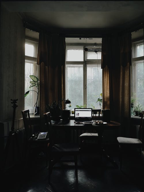 Interior of workspace with laptop