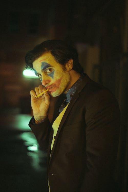 Man in Black Suit Smoking Cigarette