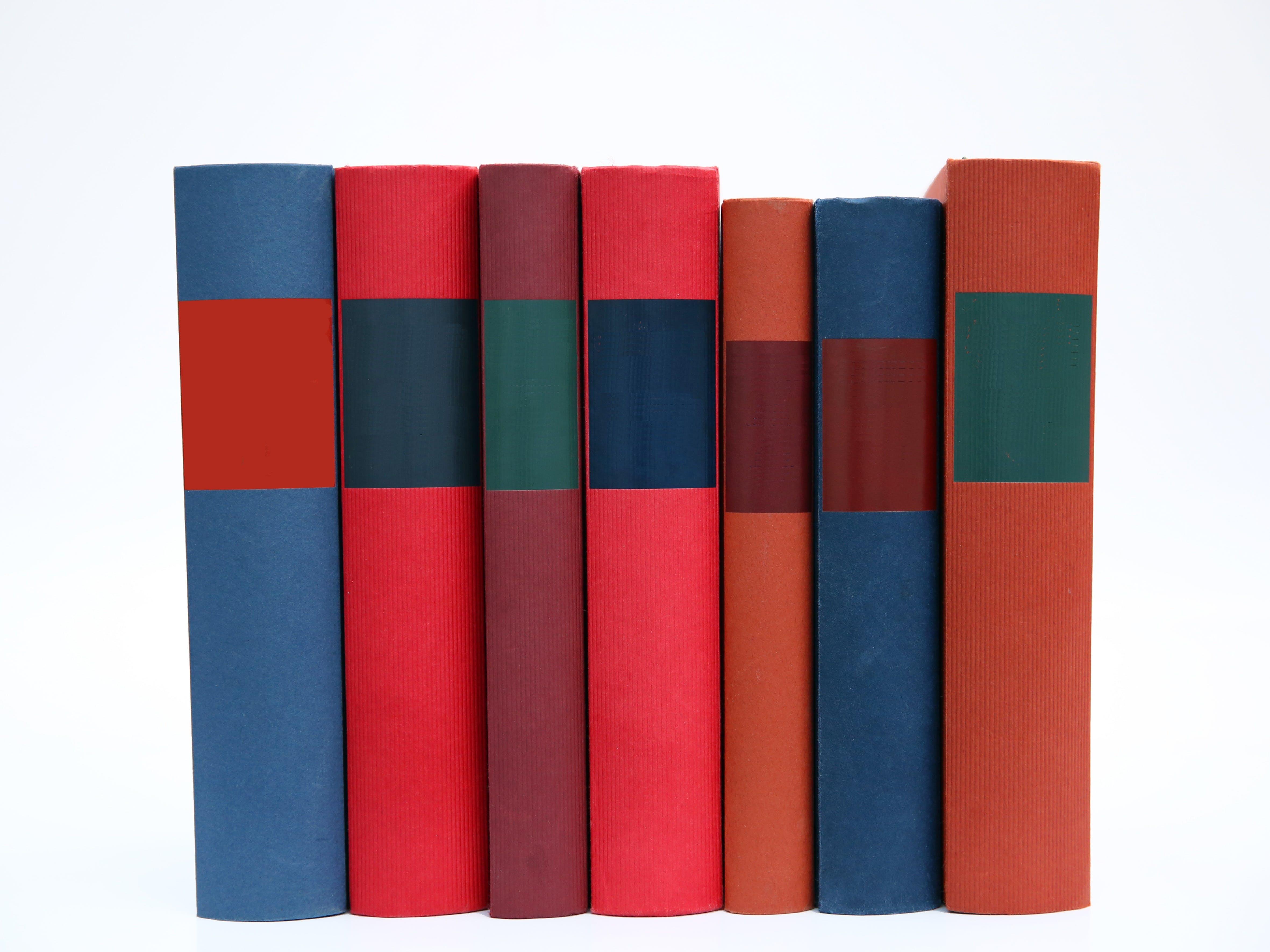 Foto stok gratis baris, buku-buku, ditumpuk, label